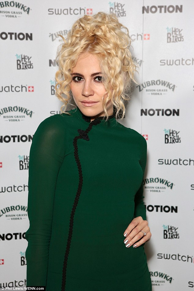 A ring thing: Pixie Lott was yet again proudly displaying the eye-popping rock gifted to her from fiance Oliver Cheshire as she attended the notionmagazine.com re-launch party on Tuesday night