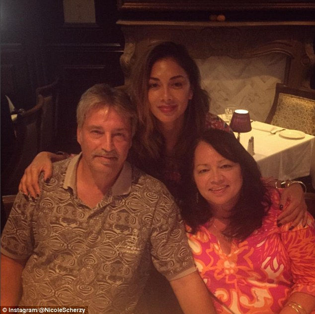 Family values: Nicole, who was raised Catholic, was born in Hawaii, but her mother Rosemary Elikolani split from her father Alfonso Valiente when she was very young. She is pictured with her mother and stepfather Gary Scherzinger