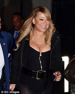 Happy: Mariah looked to be in a great mood exiting NYC's Beacon Theater December 7