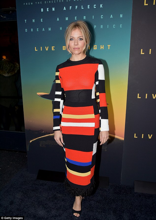 Sixties siren!Sienna Miller rocked a long-sleeved dress that clung to her slender physique and featured a 60's-inspired, colour block pattern