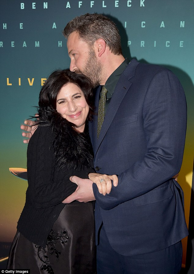 What a sweetheart! Affleck planted a friendly kiss on Warner Bros executive Sue Kroll's head