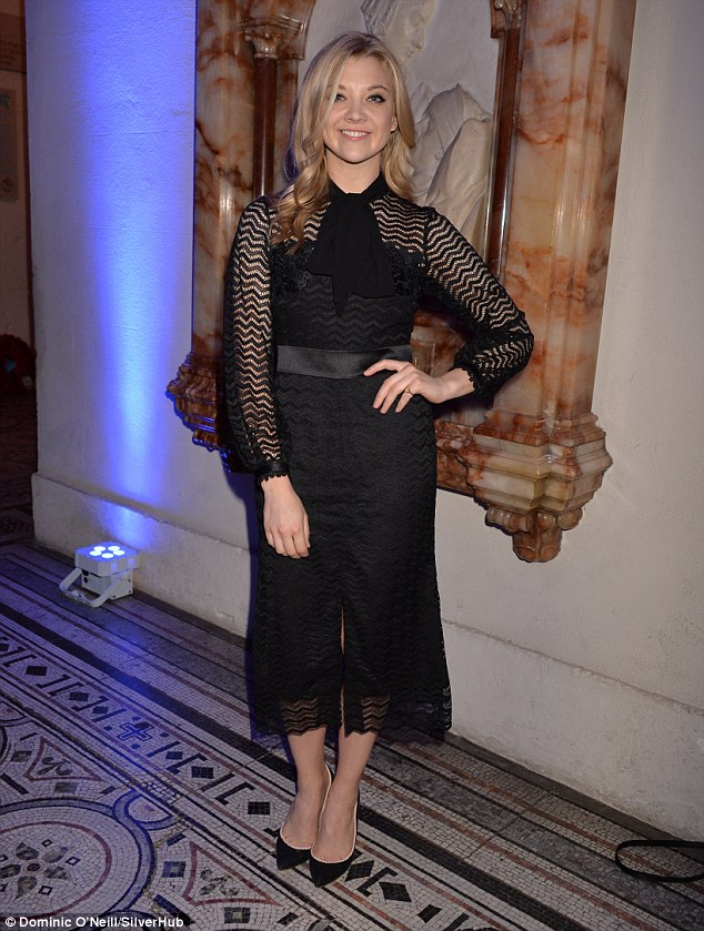 Victoriana chic: Natalie Dormer opted to borrow from a different chapter of history on Tuesday evening as she slipped into a stunning Victoriana-inspired black gown while rubbing shoulders with her fellow stars at a charity carol concert at St Paul's Cathedral