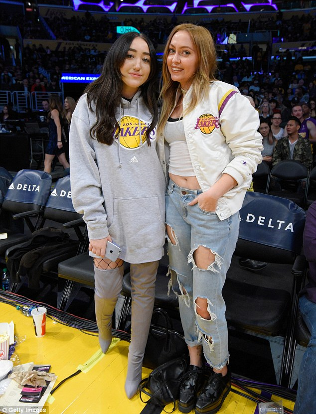 Supportive siblings: Noah is pictured with her other sister Brandi, 29, at a Lakers game on December 11