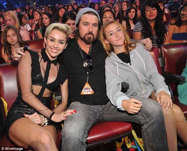 Close knit: Just like Miley, Noah had her showbiz start on shows like her father Billy Ray's series Doc and her sister Miley's hit Hannah Montana. The girls are pictured with Billy in August 2013