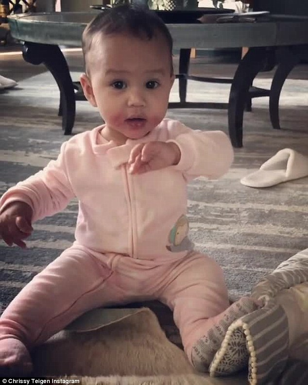 Say hi for the camera! Chrissy Teigen posted an adorable video of her eight-month-old daughter Luna on Tuesday as she waved to her dad John Legend