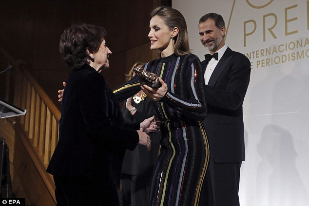 A former news anchor, the Queen, right, presented journalist Victoria Prego, left, with a special award named after newspaper ABC's founder Luca de Tena