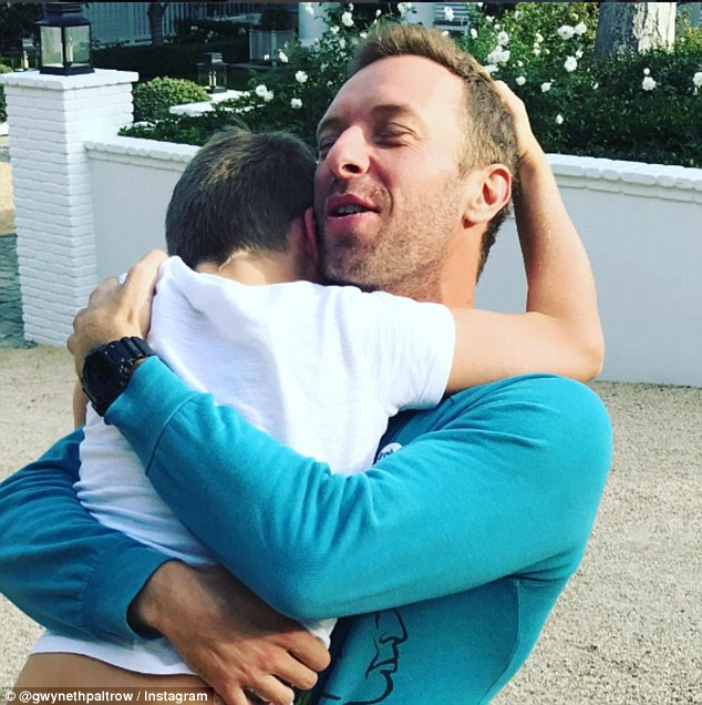 Close: Chris' ex-wife Gwyneth Paltrow posted this sweet snap of the Coldplay frontman embracing Moses on Thanksgiving