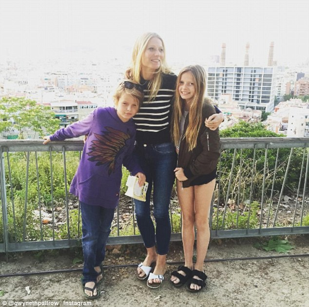 Family first: Chris is still close to Gwyneth, pictured with the couple's two children