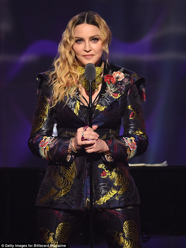 Topical issue: Lady Gaga put her differences aside with Madonna to praise the singer for the 'brave' speech she gave when receiving the Woman Of The Year gong at the Billboard Music Awards