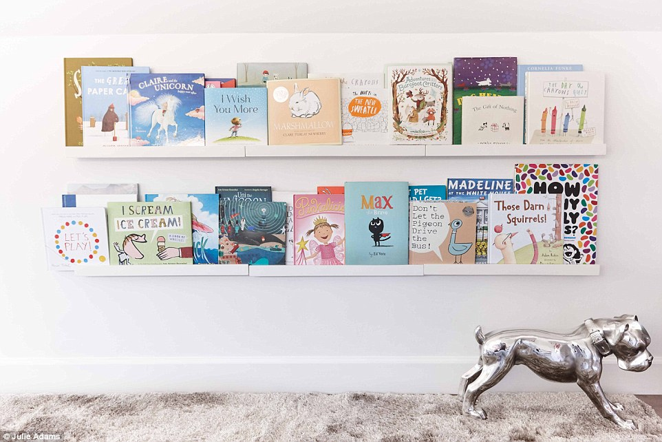 Family-friendly: A white wall features two rails for holding children's reading books