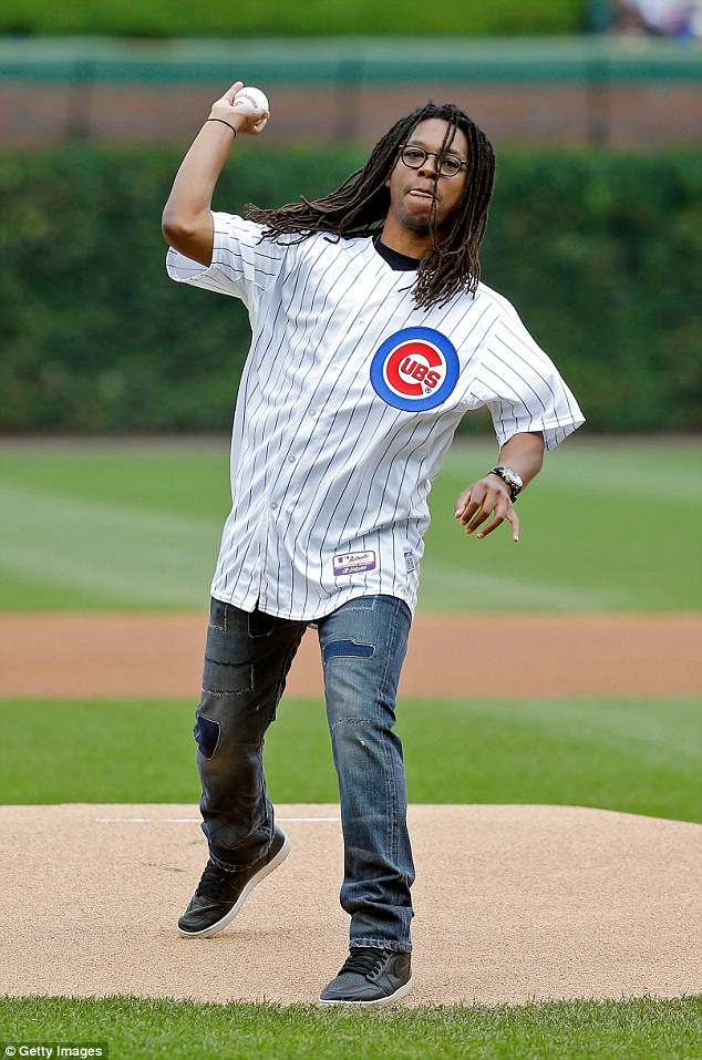Still swinging: Lupe is pictured throwing the ceremonial first pitch at a Chicago Cubs game back in September