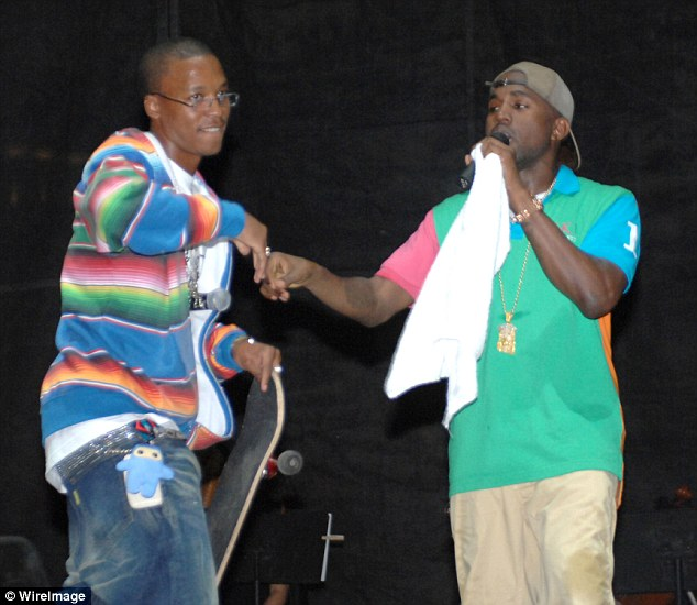 Dynamic duo: He made his name being featured on 2005 Kanye West single Touch The Sky and has worked closely with the 39-year-old rapper for over a decade, as they are pictured together in Chicago back in August 2006