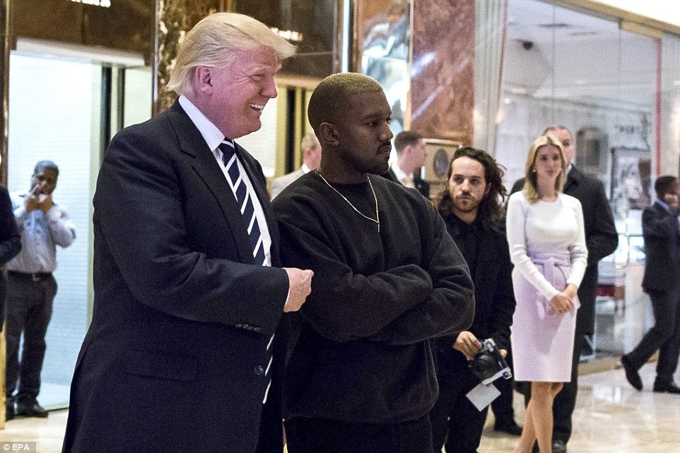 Happy mood: Trump laughed as he posed with a largely unsmiling Kanye West after their Trump Tower meeting, while daughter Ivanka watched at his right