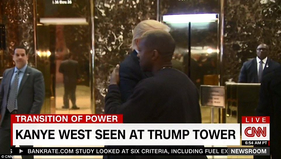 Presidential gesture: Donald Trump and Kanye West embraced after the president-elect escorted the rapper to the lobby of Trump Tower