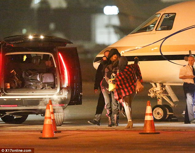 Seeya later: Khloe hugged a gal pal before driving off on Sunday night