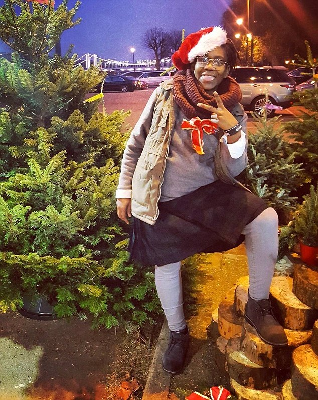 The woman that sold them the tree, Zaqia Crawford (pictured), said they were 'doing lots of touching and laughing' as they picked out the tree - although she had no idea who they were