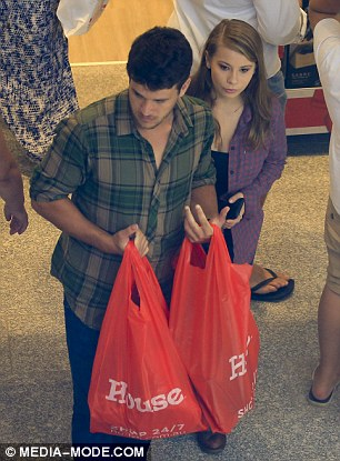 Buying up big: After spending some time in the shop, they walked out with multiple shopping bags that read 'House' on the front