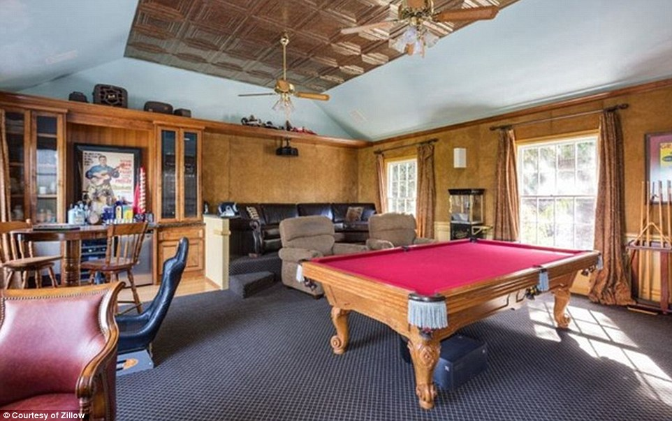 The home features high ceilings and delicate wood working, as well as a game room and theater for the family to enjoy together