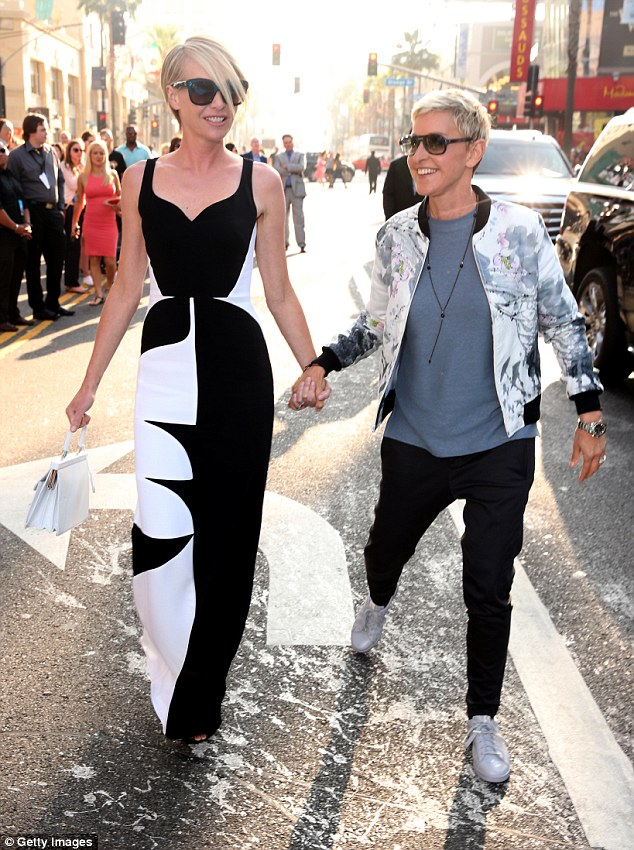 Blood boiling: The redhead said Ellen is 'livid' that she called her out for having a 'mean streak' in her new book. Here DeGeneres (right) is seen with Portia de Rossi in June