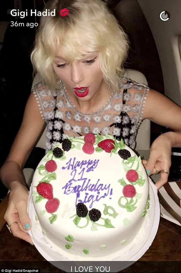 Gushing: The model shared this adorable snap of the singer with the cake as she captioned it: 'I LOVE YOU'