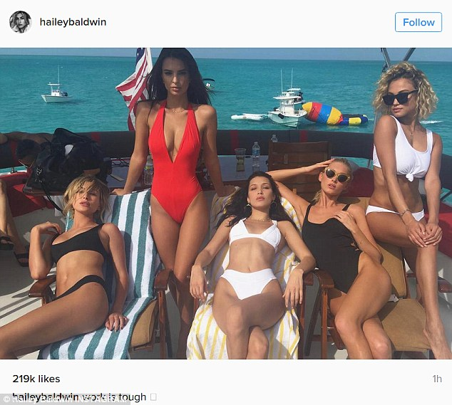 Model behavior: Hailey Baldwin shared a photo from her own social media account on Monday, lounging with her glamorous girl squad