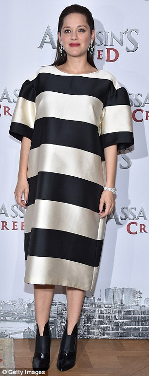 Go bold: Marion Cotillard, 41, covered her bump in this Dries Van Noten dress recently