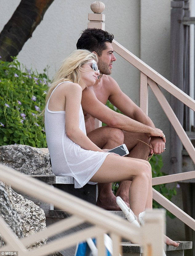 He's got her heart: She cosied up to her Made In Chelsea beau as they sat on the steps together, by the beach