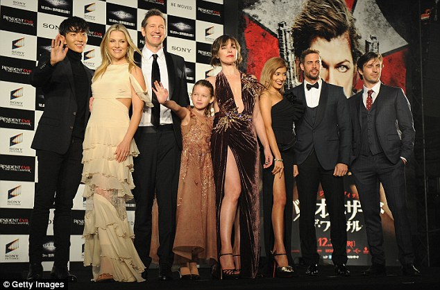 Met the gang: Mila was joined at the event by the rest of the film's cast and her husband, Paul W. S. Anderson (centre left), the film's director and writer, and Ever, who plays the Red Queen in the new movie