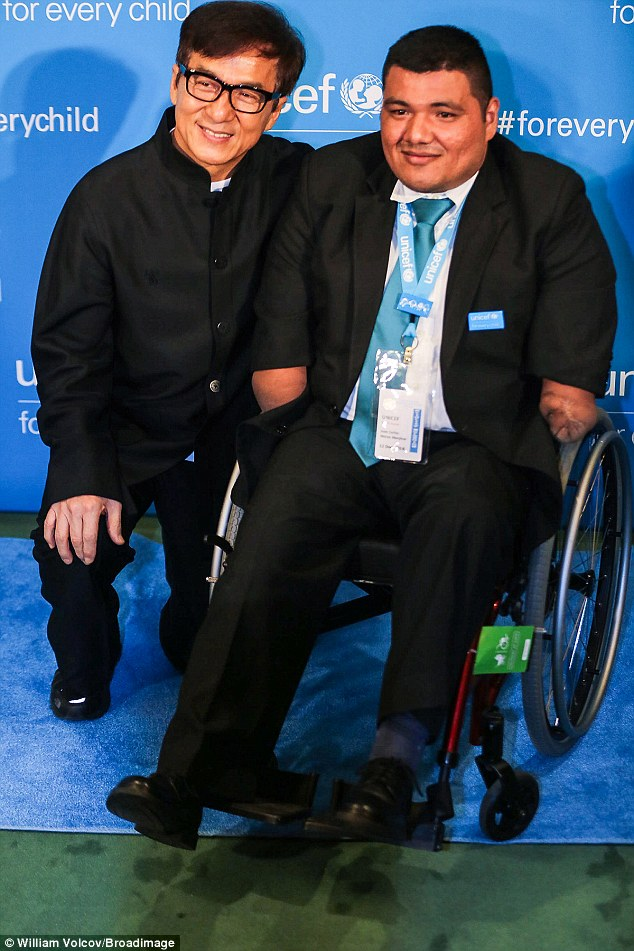 Ambassador and advocate: Jackie Chan, who's been a Unicef Global Ambassador for 12 years, posed alongsideJuan Carlos Morán Menjivar, whom the group enabled to get prosthetic legs after he lost his to a landmine
