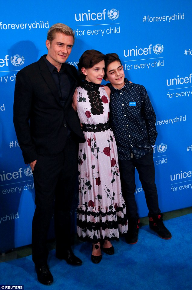 Trio: Whilst on the turquoise carpet, the Stranger Things star and and Bloom got in a bit of posing alongside Syrian refugee Mustafa Al Said