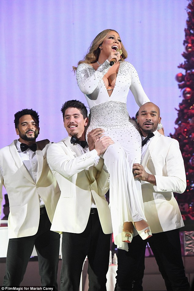Back for more:Mariah, pictured performing on December 5, will continue her holiday concert series, Mariah Carey: All I Want For Christmas Is You, on December 11, 13, 14, and 15