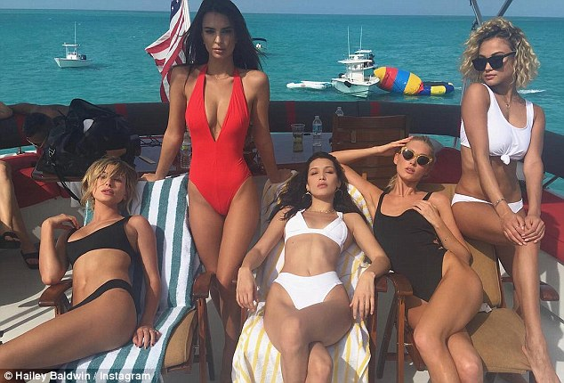 Sexy siren: Hailey Baldwin, 20, sizzled in a skimpy black bikini as she posed in a Instagram snap with models (L-R) Emily Ratajowski, Bella Hadid, Elsa Hosk and Rose Betram in Bahamas