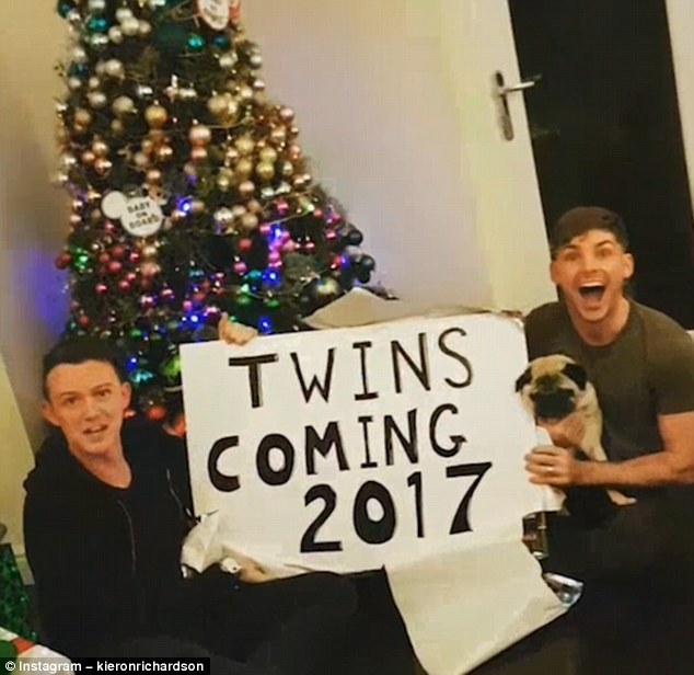The greatest gift: The couple shared the news in a festive-themed video, which showed two 'Baby on board' signs hung up on a Christmas tree, before revealing Kieron and Carl sat on the floor opening a present