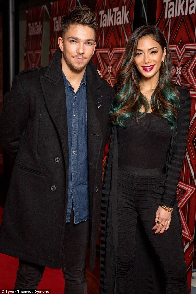 Fighting to the finish: Glamorous Nicole Scherzinger posed up a storm beside her boy Matt Terry, who won the show last year