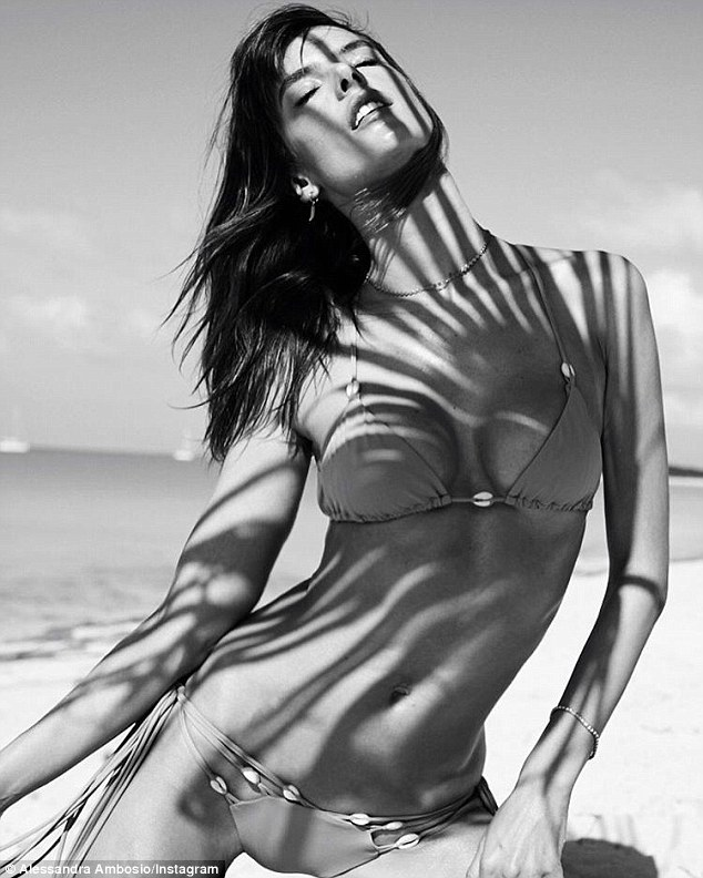 Stunning: Hitting the beach during her stay on small Bahamian island Norman's Cay, Alessandra Ambrosio appeared to be in fine form while striking a brooding pose in a barely there two-piece