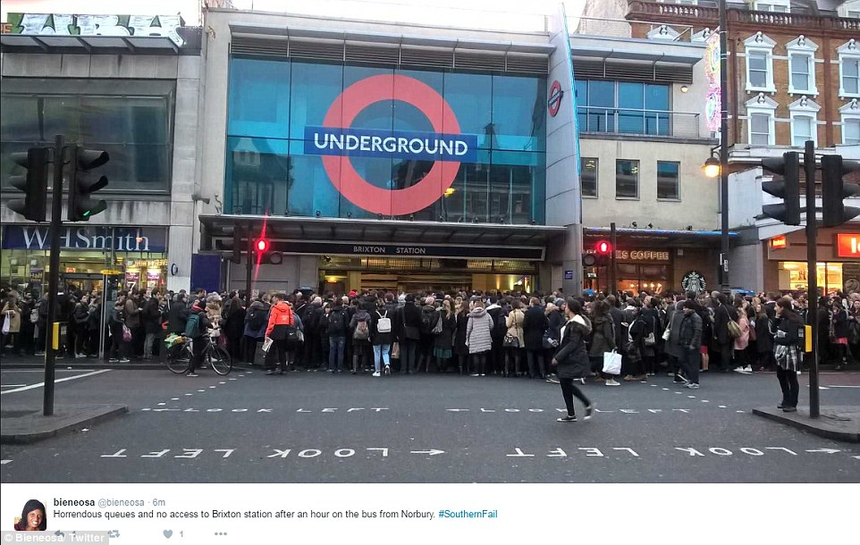 Thousands of passengers who usually rely on Southern Rail services were forced to pack into London Overground and London Underground services. Pictured, hundreds queue on the street outside Brixton Tube station this morning