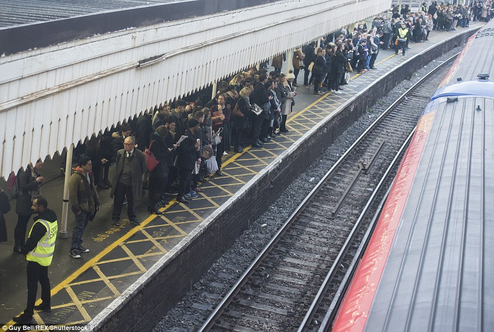 Commuters packed on to some platforms at Clapham Junction station, pictured, while others were closed completely