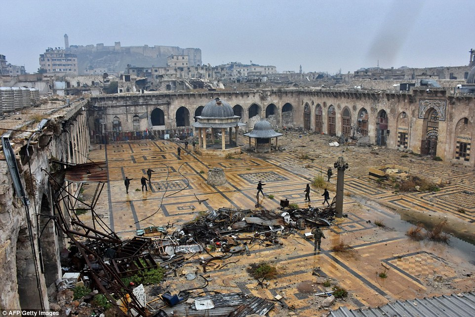 Several of the walls surrounding the UNESCO-listed building have been destroyed and fighters have been inspected looking on at the ruins