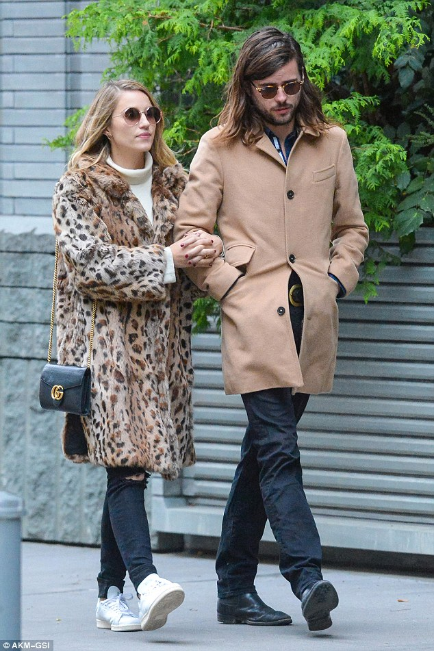 Newlyweds: Dianna Agron and Winston Marshall seemed to be settling well into married life as they enjoyed a romantic stroll arm in arm in Manhattan on Monday