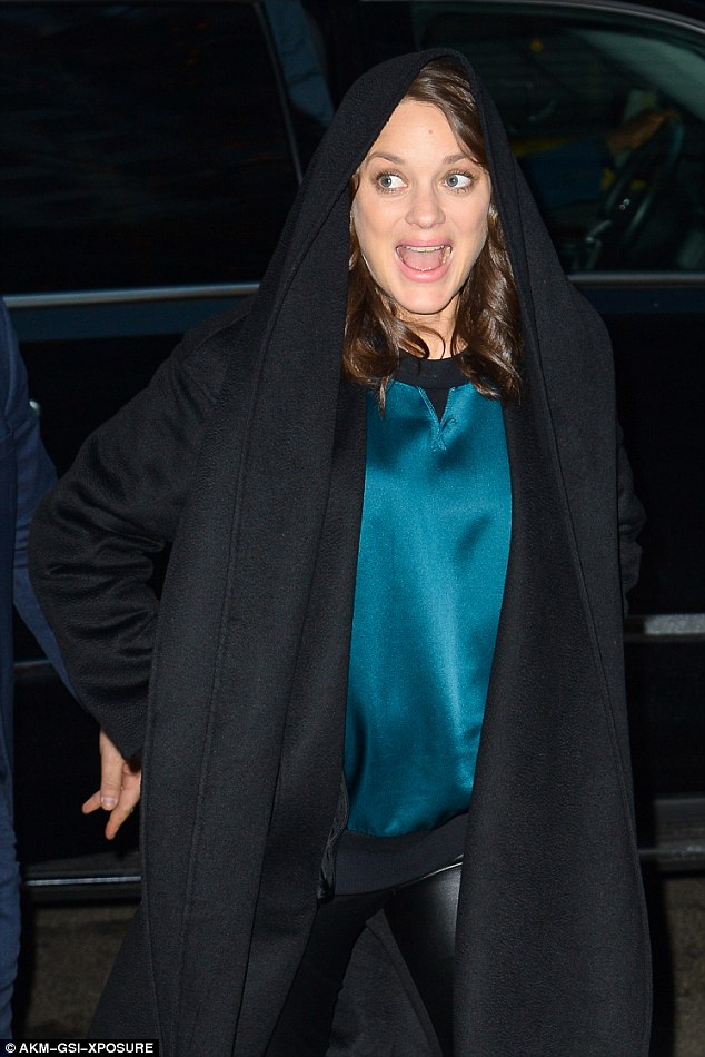 Glowing: Marion looked in fine spirits, smiling brightly as she stepped out of her car and made her way to AOL's offices