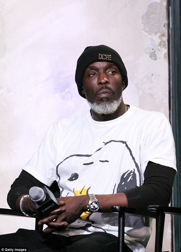 Cutting a cool figure: Williams rocked a quirky Snoopy tee, a silver beard and a beanie for a dressed down vibe