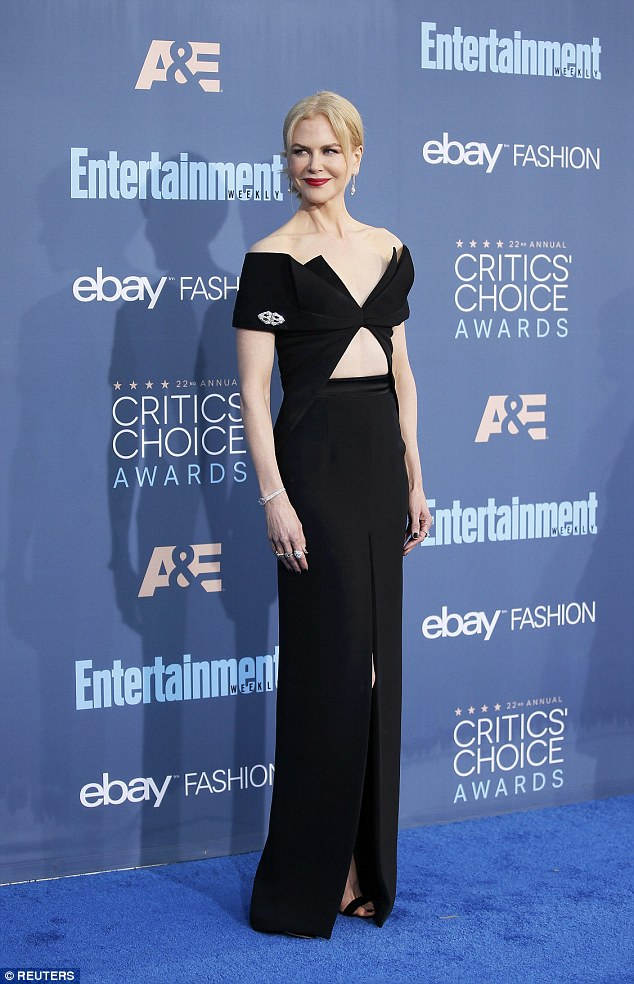 So glam: Nicole in more familiar guise in a black gown at the Critics' Choice Awards in Los Angeles on  Sunday night