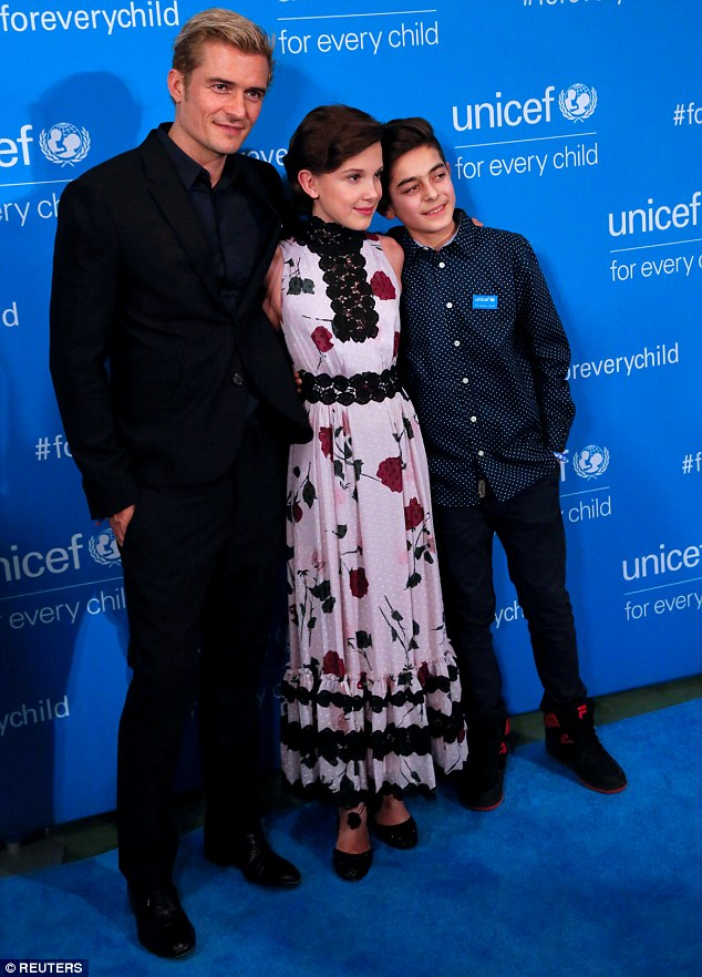 Showing their support: Millie posed on the red carpet with Orlando Bloom and Syrian refugee advocate Mustafa Al Said