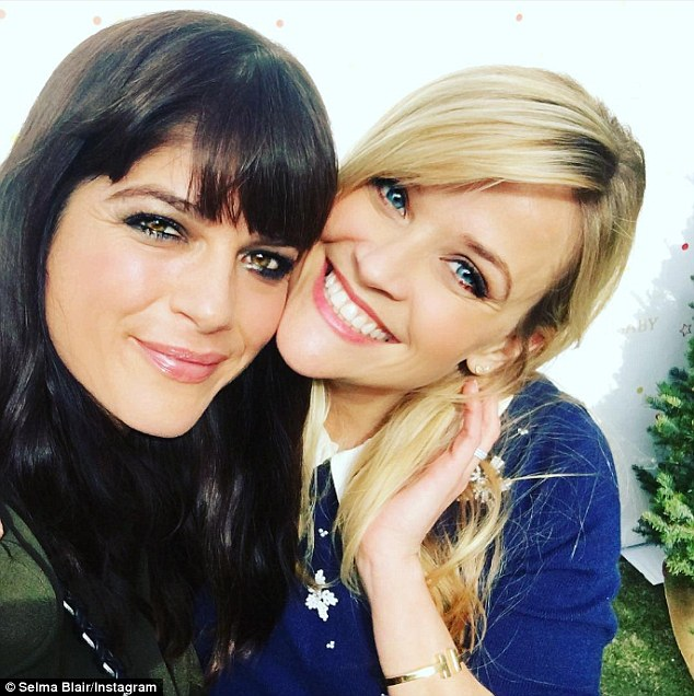 'Happy holidays y'all!!' Reese Witherspoon (R) merrily reunited with her Cruel Intentions co-star Selma Blair (L) at The Baby2Baby Snow Day in Los Angeles on Monday