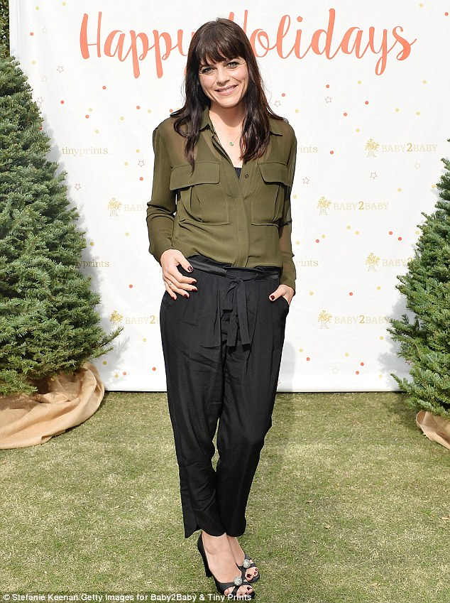 Understated: The Ordinary World actress was also dressed conservatively in an olive button-down blouse tucked into black drawstring trousers and matching peep-toe pumps