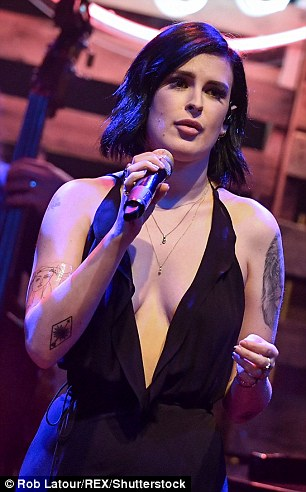 Crowd pleaser!The 28-year-old had the crowd in the palm of her hands - and not just for her vocals - as she rocked the house in a plunging black maxi dress
