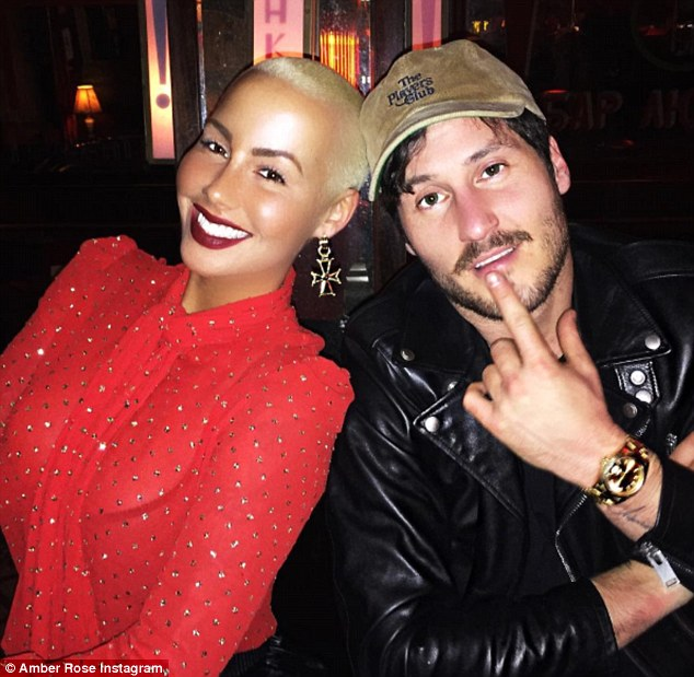 Aww: The talk show host shared a snap of herself that night cosying up to her new beau,Val Chmerkovskiy