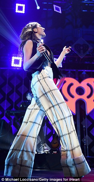 Teetering: 18-year-old Daya - born Grace Tandon - performed her hit Don't Let Me Down while clad in white wide-leg trousers and a black waistcoat selected by stylist Andrew Gelwicks