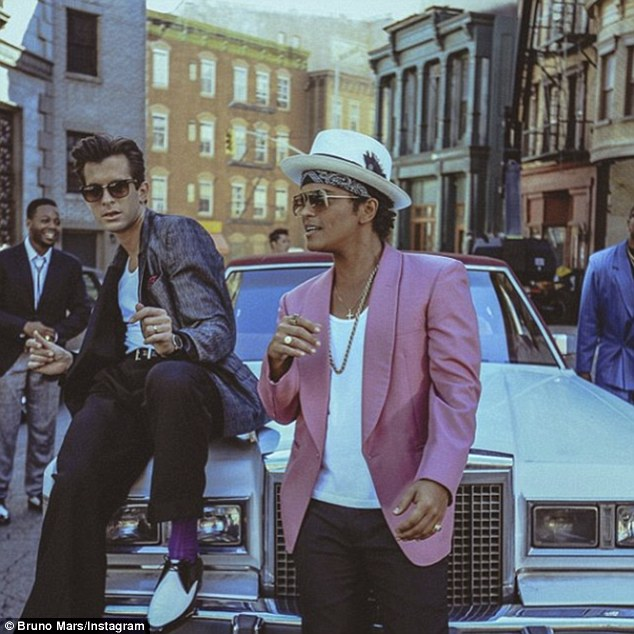 Plagiarist? But not all is golden with the 5ft5in Hawaiian, who's still battling a copyright infringement lawsuit claiming Mark Ronson's song UpTown Funk 'ripped off' Collage's 1983 track Young Girls