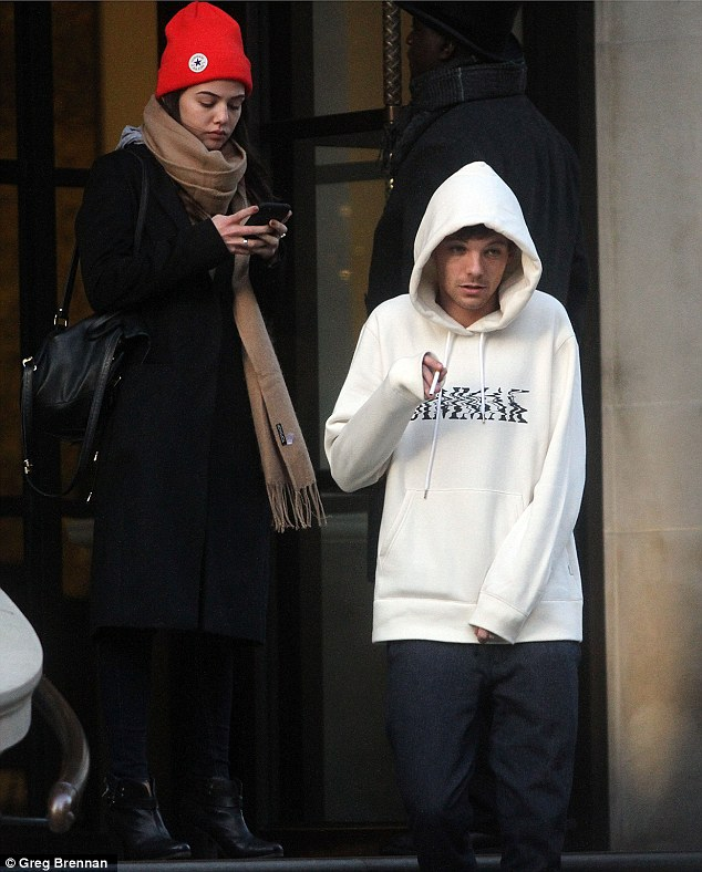 Keeping a low-profile: Wrapped up against the cold in a thick white hoodie which he teamed with jeans and white slippers, the Doncaster-born singer cut an inconspicuous figure.